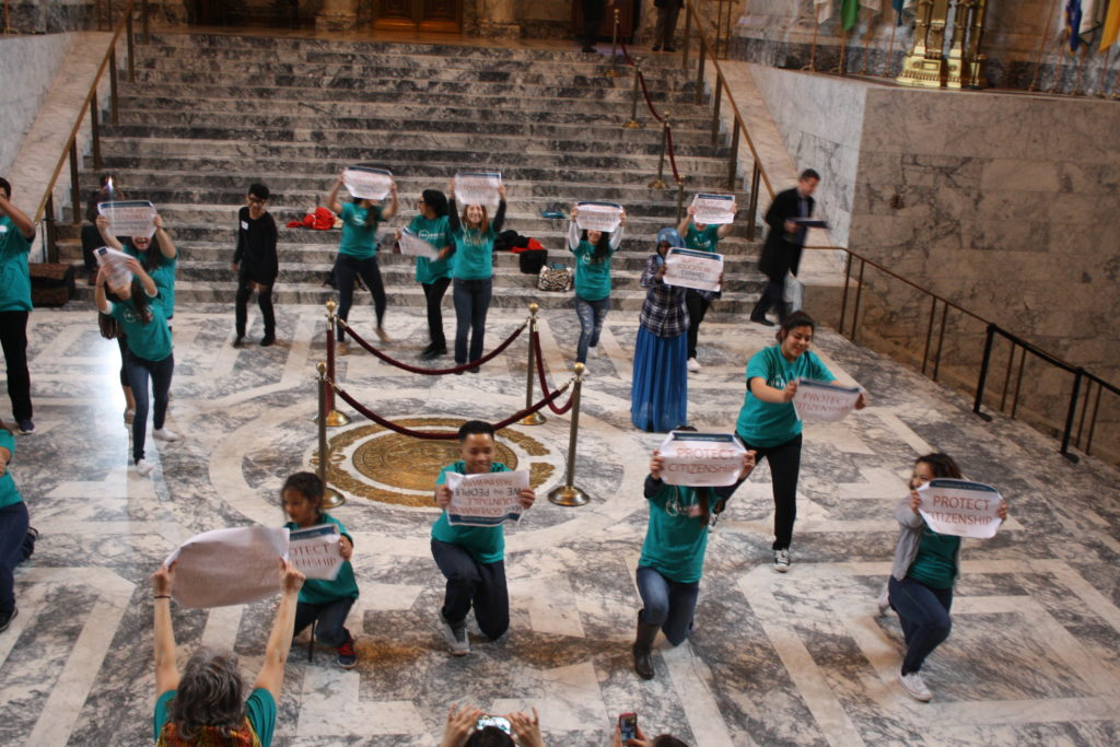 OneAmerica youth flash mob dancing in rotunda at state capitol building, Olympia Washington