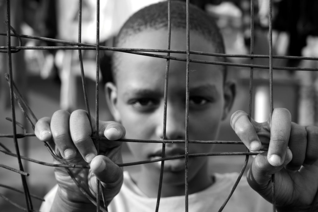 boy in a cage